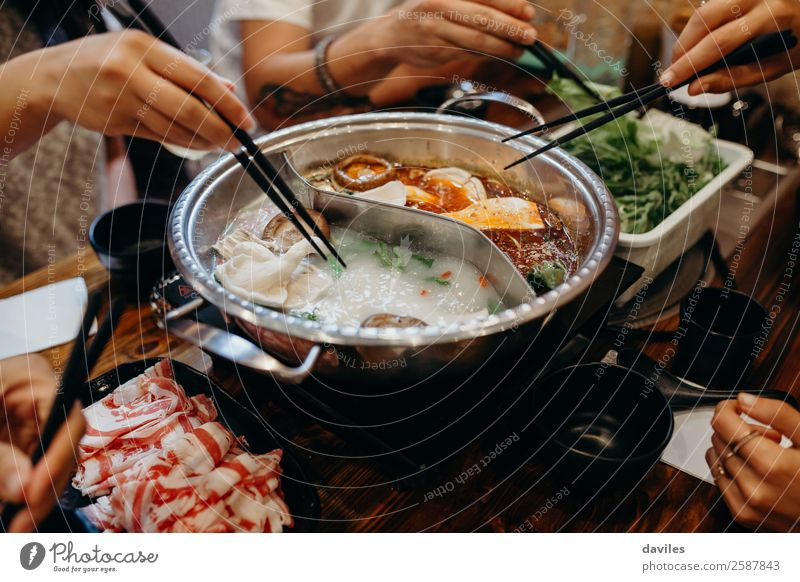 Korean hot pot and people taking food with chopsticks. Meat Seafood Vegetable Soup Stew Eating Pot Lifestyle Vacation & Travel Restaurant Human being Hand 3