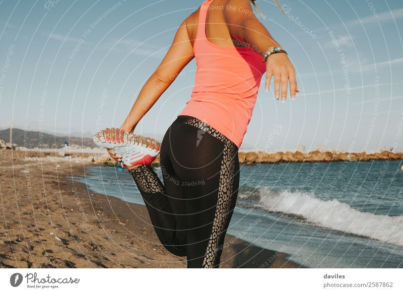 Girl body while stretching legs at sea shore. Lifestyle Body Summer Beach Ocean Sports Fitness Sports Training Jogging Human being Feminine Young woman
