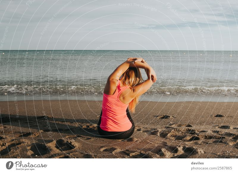 Sportsgirl stretching at the beach. Human being Youth (Young adults) Young woman Summer Ocean Beach 18 - 30 years Lifestyle Adults Feminine Health care Body