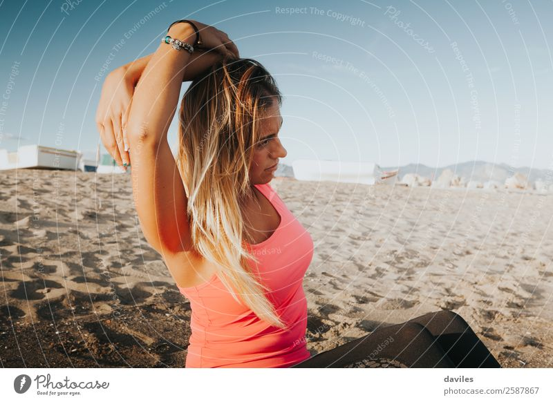 Blonde girl stretching on the beach. Lifestyle Athletic Fitness Well-being Summer Beach Sports Sports Training Yoga Human being Feminine Young woman