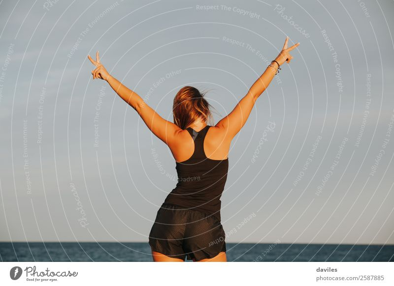 Athlete woman celebrating victory outdoors. Lifestyle Fitness Wellness Ocean Sports Sports Training Success Human being Feminine Woman Adults Arm Hand Fingers 1