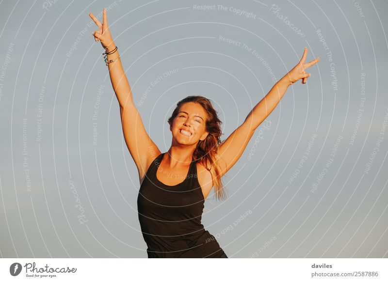 Smiling woman celebrates win Lifestyle Joy Beautiful Athletic Fitness Freedom Feasts & Celebrations Sports Sports Training Success Human being Feminine