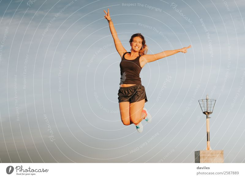 Athlete woman jumping and celebrating victory outdoors. Lifestyle Joy Wellness Summer Feasts & Celebrations Sports Sportsperson Success Human being Feminine