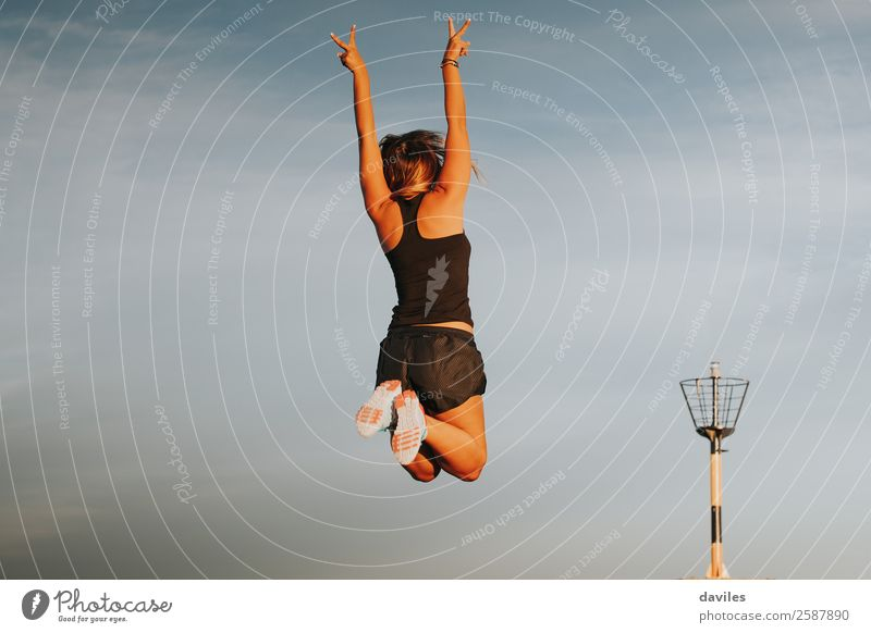 Sportswoman celebrating win jumping. Woman Human being Sky Nature Youth (Young adults) Young woman Hand Joy Mountain 18 - 30 years Lifestyle Adults