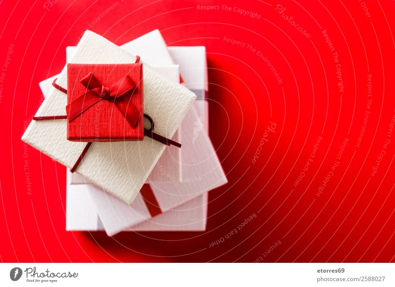 White and red gift boxes on red background. Red Feasts & Celebrations Copy Space Decoration Birthday Gift String Box Valentine's Day Present Day Mother's Day