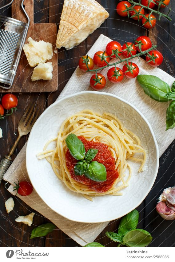 Spaghetti pasta with tomato sauce, basil and cheese Vegetable Herbs and spices Nutrition Lunch Dinner Vegetarian diet Plate Fork Spoon Restaurant Leaf Wood Dark