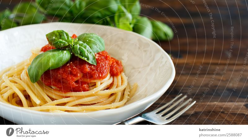Spaghetti pasta with tomato sauce, basil and cheese Green Red Dish Leaf Dark Wood Copy Space Brown Nutrition Fresh Cooking Herbs and spices Vegetable Tradition
