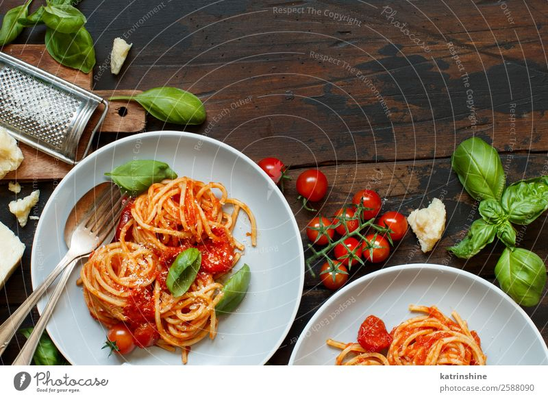 Spaghetti pasta with tomato sauce, basil and cheese Vegetable Herbs and spices Nutrition Lunch Dinner Vegetarian diet Plate Spoon Restaurant Leaf Wood Dark