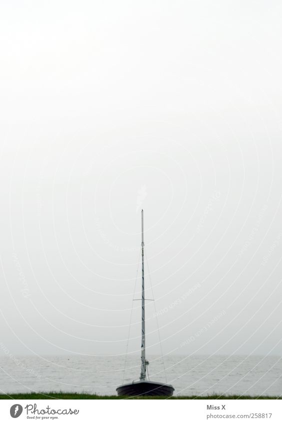 __I__ Bad weather Fog Coast Lakeside North Sea Baltic Sea Ocean Navigation Boating trip Sailboat Dark Cold Mast Colour photo Exterior shot Deserted