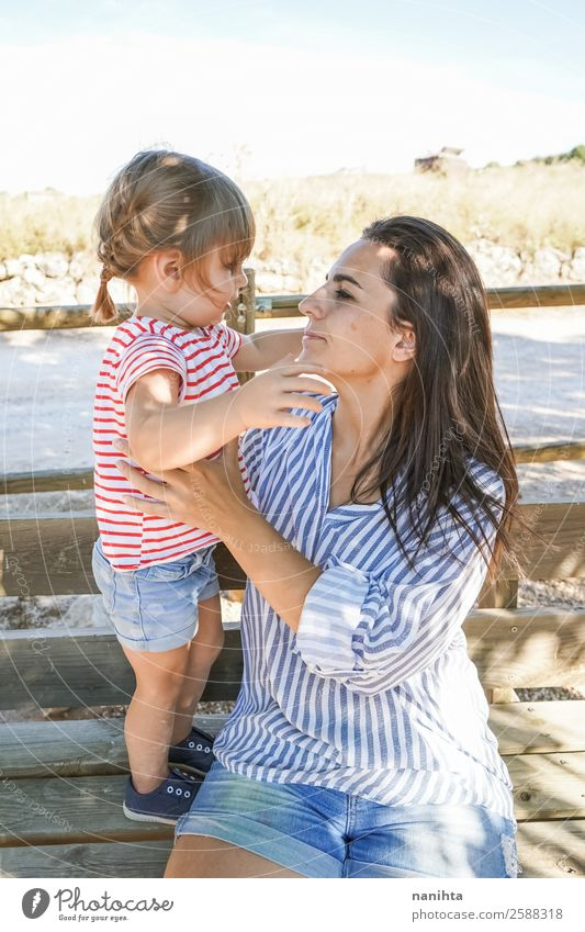 Mom and daughter spending time in the park Lifestyle Style Joy Parenting Education Human being Feminine Child Toddler Girl Young woman Youth (Young adults)