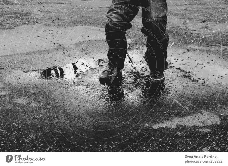 . Boy (child) Legs Feet 1 Human being 3 - 8 years Child Infancy Street Tar Asphalt Jeans Footwear Chucks Movement Jump Dirty Wet Joie de vivre (Vitality)