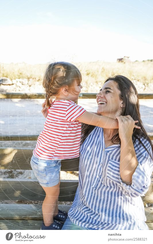 Adorable girl and her mother in a summer day Lifestyle Joy Wellness Well-being Mother's Day Parenting Human being Feminine Child Toddler Girl Adults
