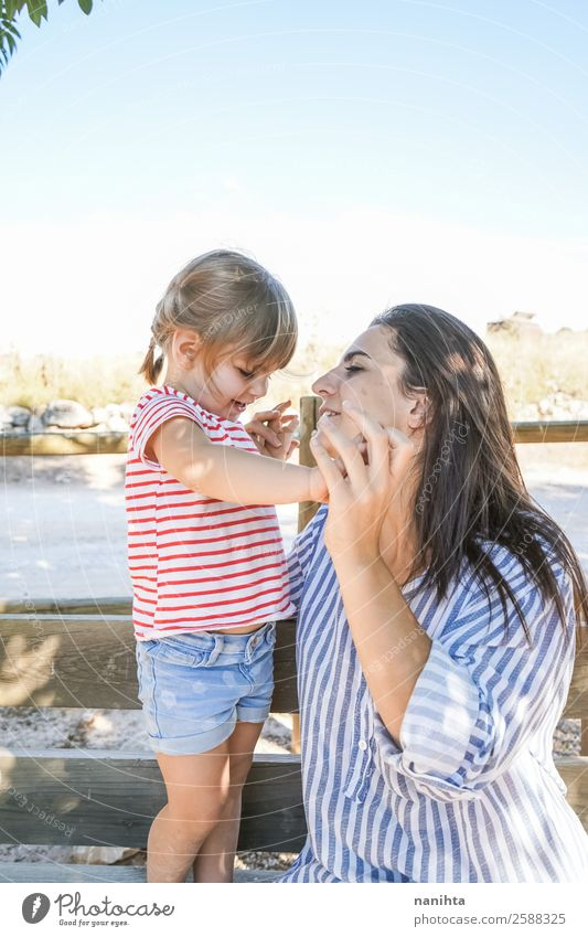 Mom and her daughter in the park Woman Child Human being Youth (Young adults) Young woman Summer Relaxation Joy Girl 18 - 30 years Lifestyle Adults Autumn Love