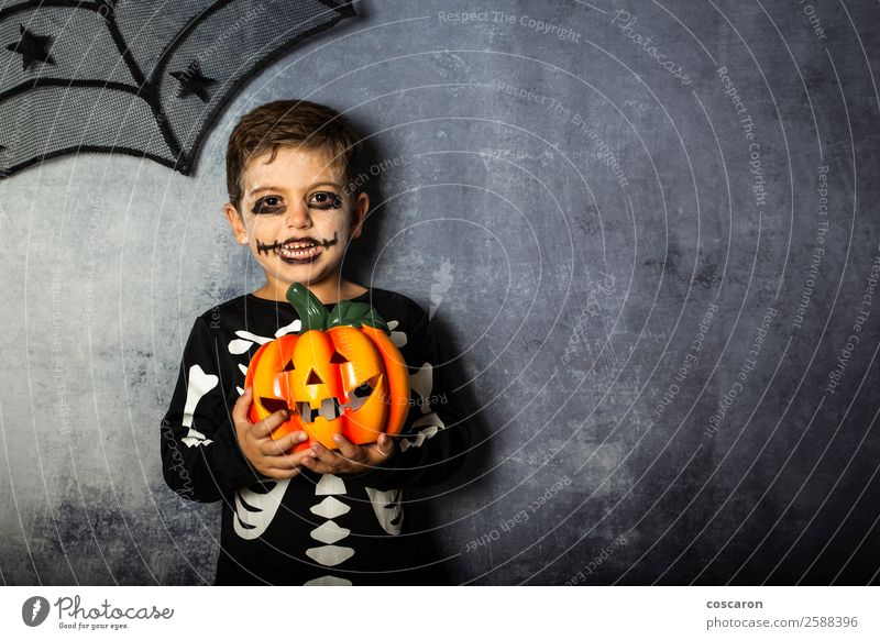 Young boy in the Skeleton costume holding Halloween pumpkin Child Human being Beautiful White Joy Black Face Life Autumn Natural Boy (child)
