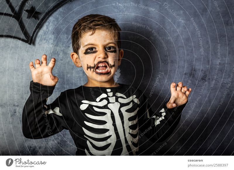 Little kid in a skeleton costume on Halloween Carnival Child Human being White Joy Black Face Happy Boy (child) Feasts & Celebrations Small Fashion Death