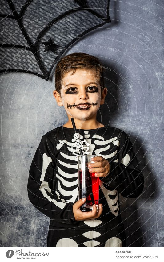 Little kid in a skeleton costume on Halloween Child Human being Beautiful Red Joy Dark Black Face Funny Happy Boy (child) Feasts & Celebrations Small Fear