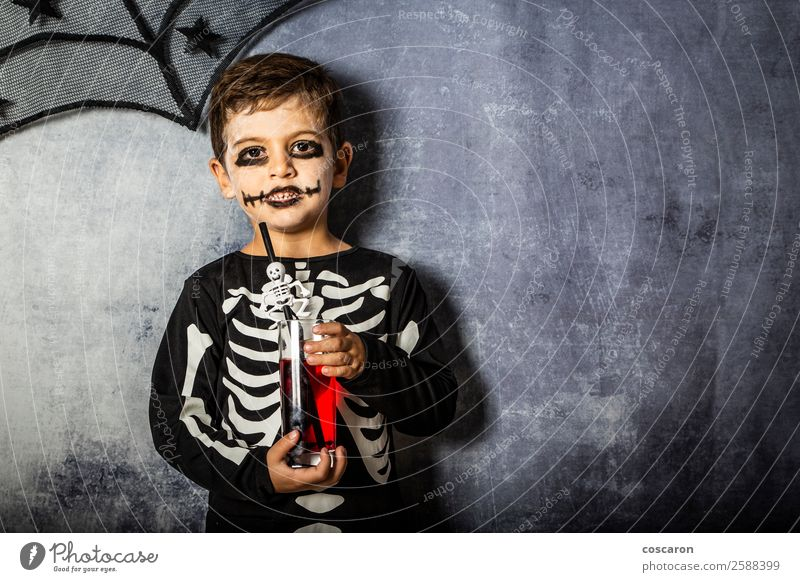 Little kid in a skeleton costume on Halloween Juice Joy Happy Beautiful Face Make-up Feasts & Celebrations Carnival Hallowe'en Fairs & Carnivals Child