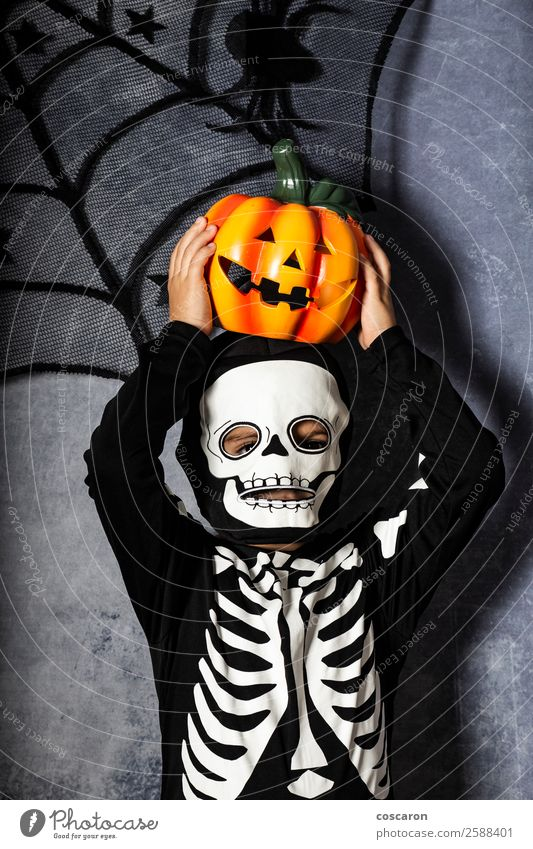 Young boy in the Skeleton costume holding Halloween pumpkin Joy Beautiful Face Mascara Life Decoration Feasts & Celebrations Carnival Hallowe'en Child Internet