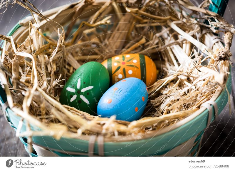Easter eggs in a basket on wooden background Egg Colour Vacation & Travel Feasts & Celebrations Public Holiday Background picture Guest Decoration Festive