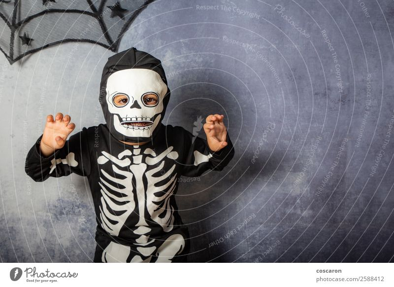 Little kid in a skeleton costume on Halloween Carnival Joy Happy Face Make-up Leisure and hobbies Feasts & Celebrations Hallowe'en Fairs & Carnivals Child
