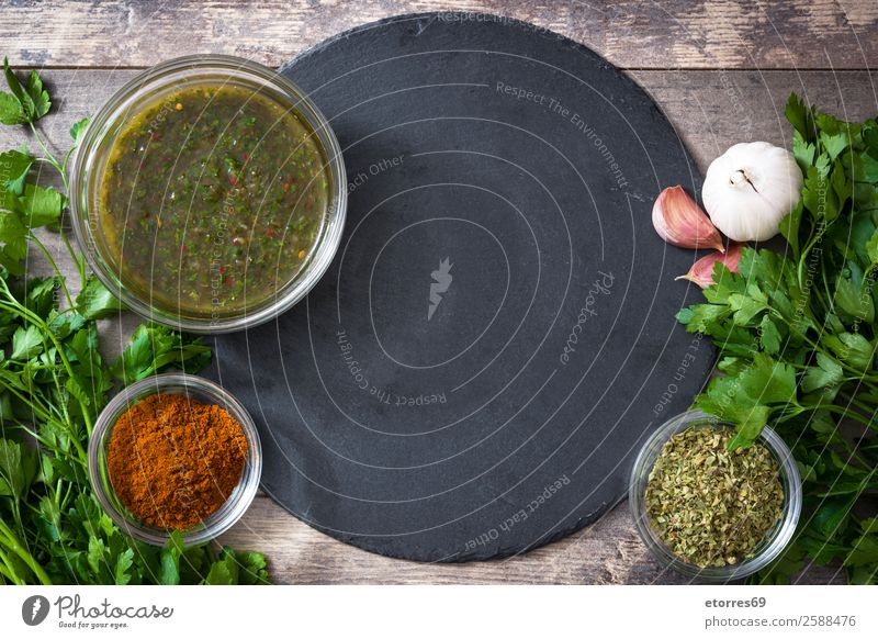 Green Chimichurri Sauce and ingredients on wooden background chimichurri Food Healthy Eating Food photograph Chili Aromatic Argentina Garlic Dish Home-made jar