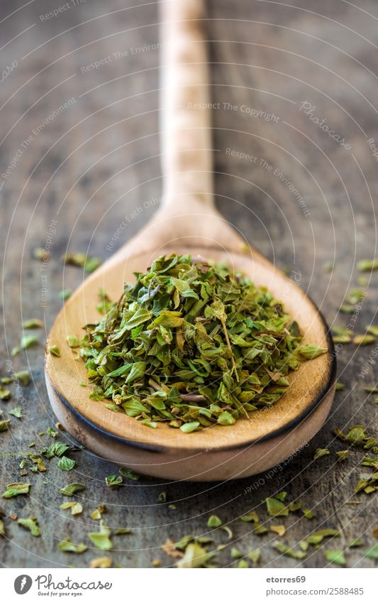 Oregano on wooden spoon on wooden background Herbs and spices Spoon Food Healthy Eating Food photograph Green Ingredients Wood Aromatic bio Vegan diet
