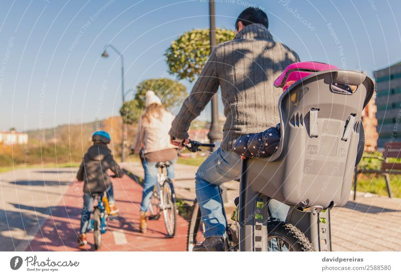 Family with children riding bicycles in the nature Lifestyle Joy Happy Leisure and hobbies Sun Winter Sports Child Baby Boy (child) Woman Adults Man Parents