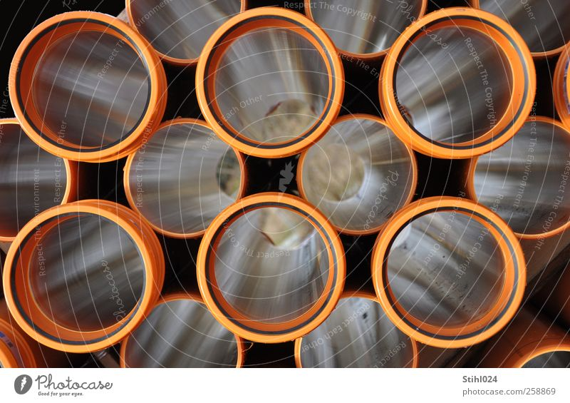 look down the tube Craftsperson Construction site Craft (trade) Conduit Pipe Effluent Plastic Lie Round Brown Disciplined Orderliness Arrangement Perspective