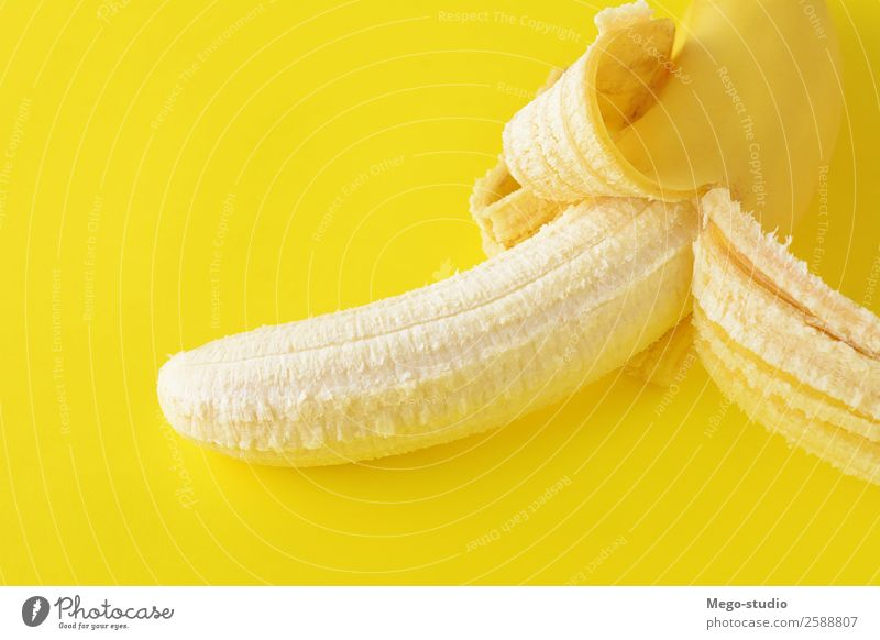 Top view. Peeled banana on yellow background. Healty concept Nature Blue Colour Eating Yellow Natural Fruit Nutrition Fresh Vantage point Skin Delicious