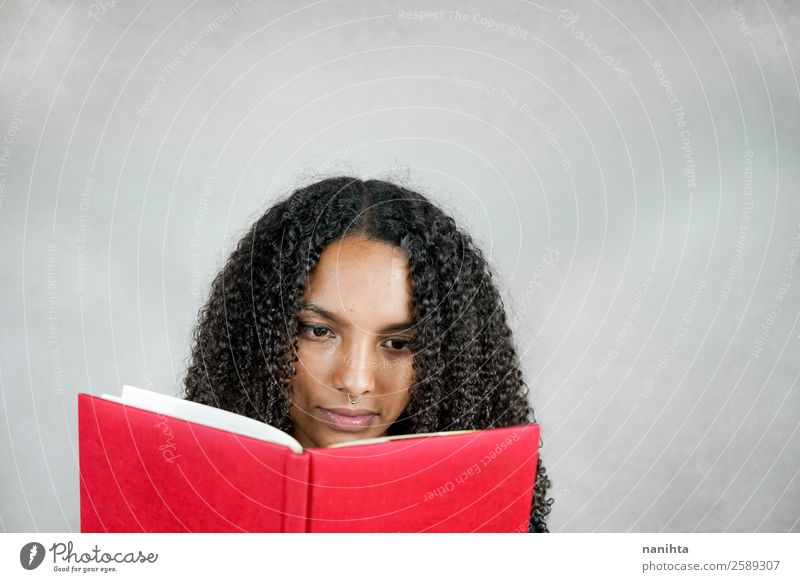 Young woman reading a book Hair and hairstyles Face Leisure and hobbies Education Adult Education Student Study Human being Feminine Youth (Young adults) Woman
