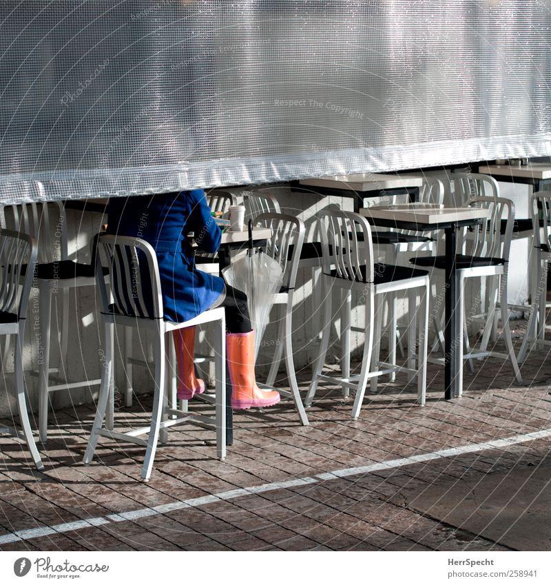 After the rain Drinking Human being Woman Adults 1 Sun Rain Tel Aviv Israel Town Blue Silver Coat Umbrella Rubber boots Sidewalk café Coffee Sit Colour photo