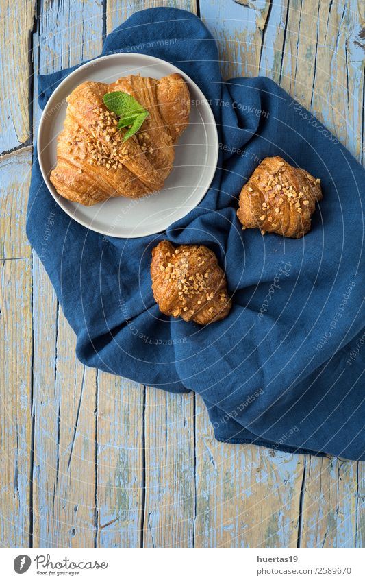 Croissant with almonds Food Bread Dessert Candy Breakfast Delicious Above Gold background sweet French Baked goods Bakery Home-made continental brunch Vertical