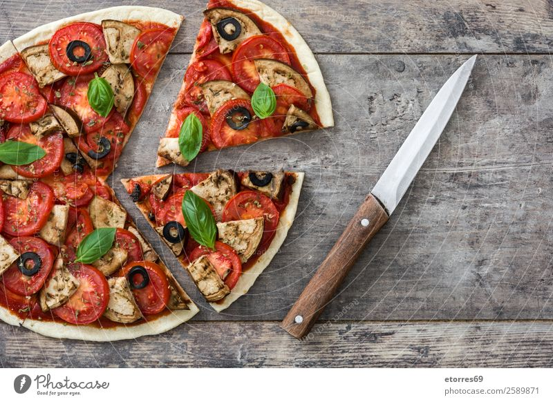 Vegetarian pizza slice Pizza Vegetarian diet Vegan diet Tomato Aubergine Oregano Basil Olive Food Healthy Eating Food photograph Dish Slice Wood Take Delicious