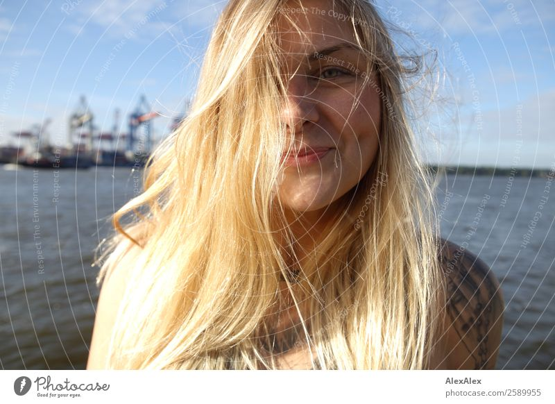 Portrait of a young woman at Hamburg harbour Lifestyle Joy Beautiful Hair and hairstyles Well-being Summer Young woman Youth (Young adults) Face brood