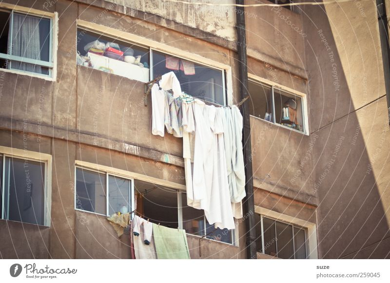 tumble dryers Living or residing Flat (apartment) Environment Summer Beautiful weather Facade Window Clothing Old Authentic Whimsical Decline Past Laundry