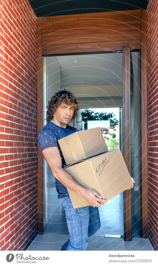 Man carrying moving boxes Lifestyle House (Residential Structure) Moving (to change residence) Kitchen Human being Adults Box Sell Authentic New Strong Effort