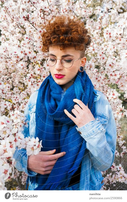 Young beautiful woman surrounded by flowers Lifestyle Style Joy Happy Beautiful Hair and hairstyles Freedom Human being Feminine Young woman