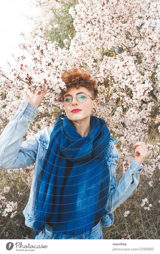 Young redhead woman surrounded by flowers Woman Human being Nature Youth (Young adults) Young woman Beautiful Tree Flower Joy 18 - 30 years Lifestyle Adults