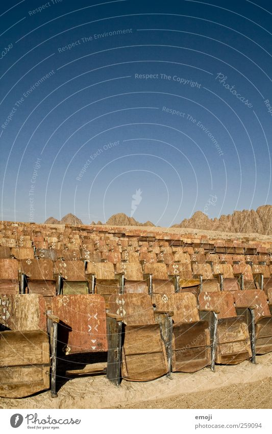 desert cinema Sky Cloudless sky Summer Desert Exceptional Blue Cinema Nature Exterior shot Seat Row of seats Movie hall Dry Colour photo Deserted Copy Space top