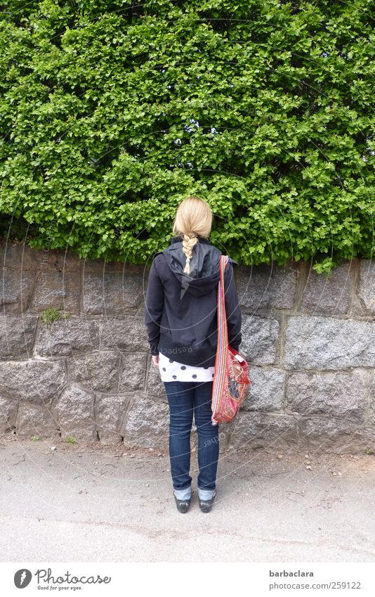 waiting Young woman Youth (Young adults) 18 - 30 years Adults Nature Beautiful weather Bushes Garden Wall (barrier) Wall (building) Street Lanes & trails Bag