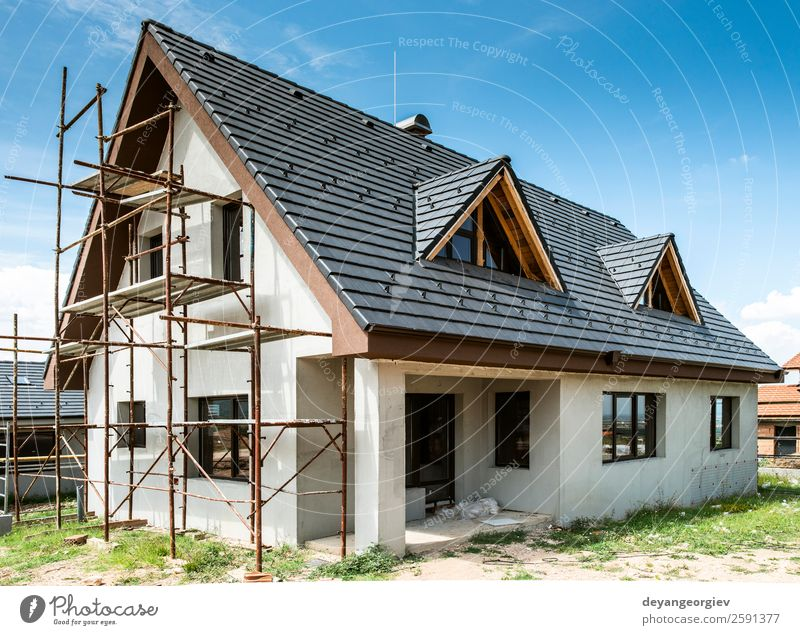 Small new build houses House (Residential Structure) Sky Architecture Facade Build Authentic New Home estate Scaffolding Housing construction roof exterior