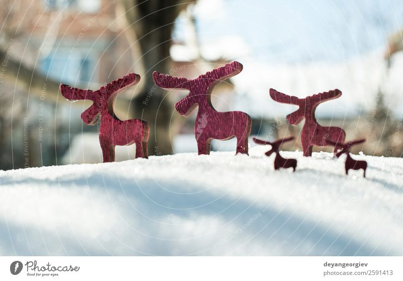 Wooden Christmas deer on snow. Christmas & Advent White Red Tree Animal Winter Snow Feasts & Celebrations Decoration Gift Symbols and metaphors New Seasons Card