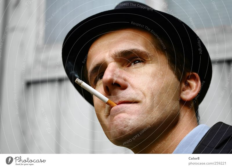 Gangster or policeman on the lookout with filter cigarette Human being Man Adults Head Face 1 30 - 45 years Cinema Film industry Video Garage door Hat