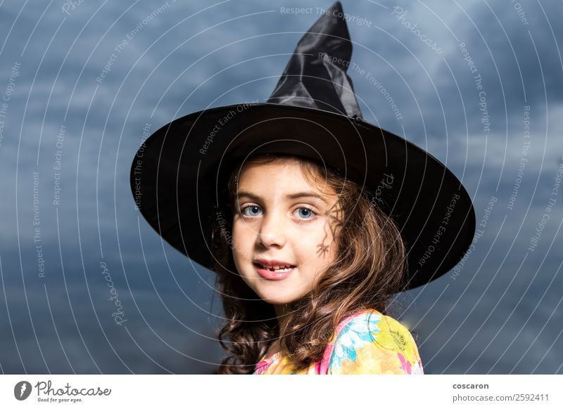 Girl disguised as a witch in Halloween Carnival Hallowe'en Child Feminine Woman Adults 3 - 8 years Infancy Sky Clouds Storm Dress Hat Brunette Cute Anger Fear