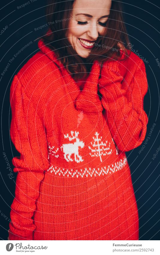 Brunette woman with red deer wool sweater Feminine Woman Adults 1 Human being 18 - 30 years Youth (Young adults) 30 - 45 years Well-being