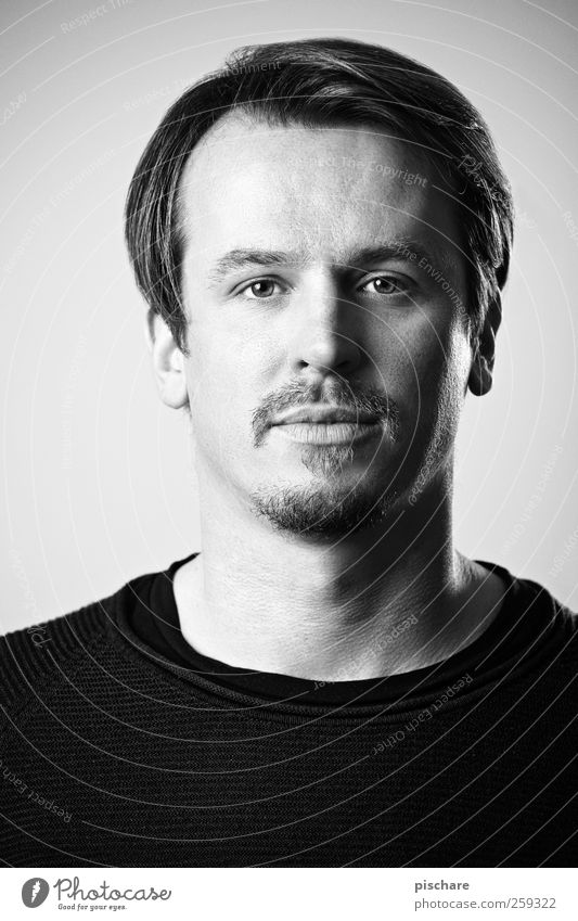 poker face Face Masculine Man Adults 30 - 45 years Brunette Part Facial hair Looking Simple Natural Calm Contentment Black & white photo Studio shot