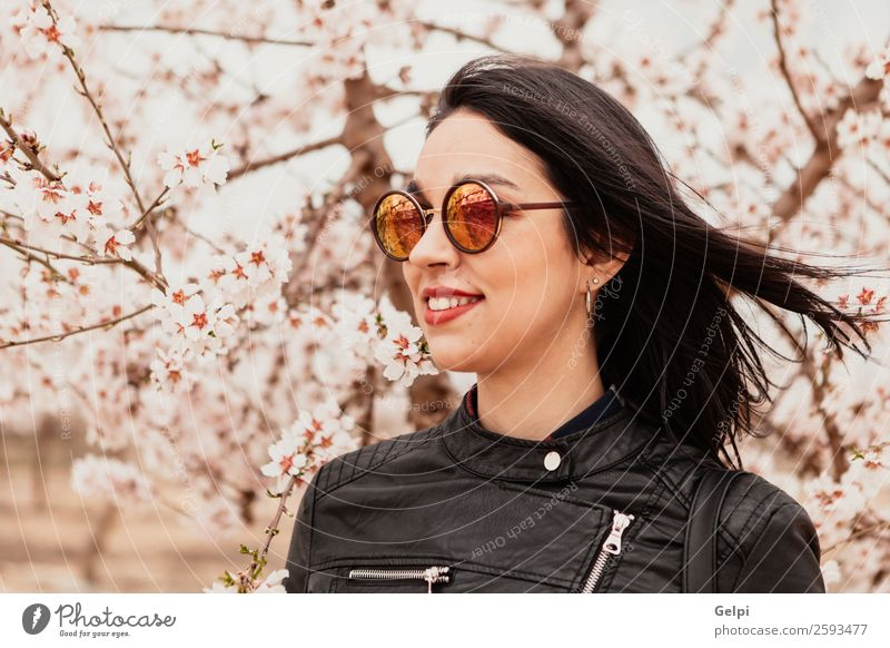 Brunette girl Style Happy Beautiful Face Garden Human being Woman Adults Nature Tree Flower Blossom Park Fashion Jacket Leather Sunglasses Smiling Happiness