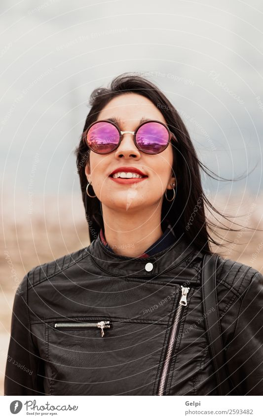 Pretty brunette girl Style Happy Beautiful Face Human being Woman Adults Lips Nature Park Fashion Jacket Leather Sunglasses Brunette Think Smiling Happiness