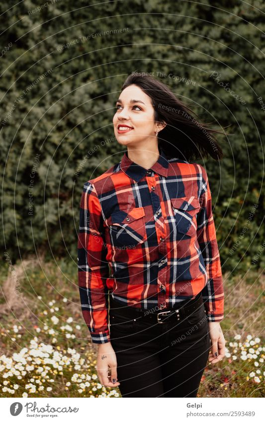 Pretty brunette girl Style Happy Beautiful Face Wellness Human being Woman Adults Lips Nature Flower Park Fashion Jacket Leather Brunette Smiling Happiness Long