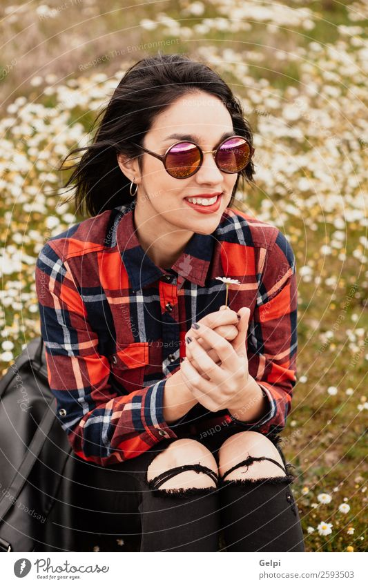 Pretty brunette girl Lifestyle Joy Happy Beautiful Face Wellness Relaxation Human being Woman Adults Nature Sky Flower Grass Blossom Park Meadow Sunglasses